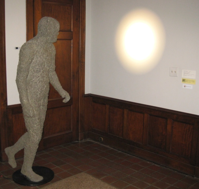 Jonathan Borofsky, Projector No. 3,214,881 (Running Male Figure), fiberglass, celluclay, resin, projector, steel and wood, 1989-90. Gift of John and Mary Pappajohn in honor of Socrates Pappajohn.